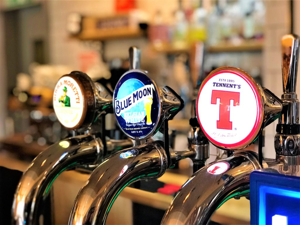 beer taps at the strathaven bar in strathaven