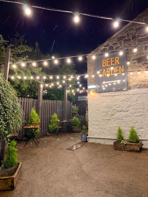 refurbished beer garden sign at the strathaven bar in strathaven